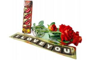 Cute combo of Big I love you chocolate with Lips chocolate pack and artificial flowers